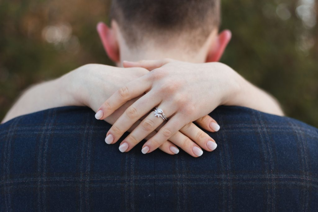 banbury oxfordshire winter wedding brides ring over grooms shoulders