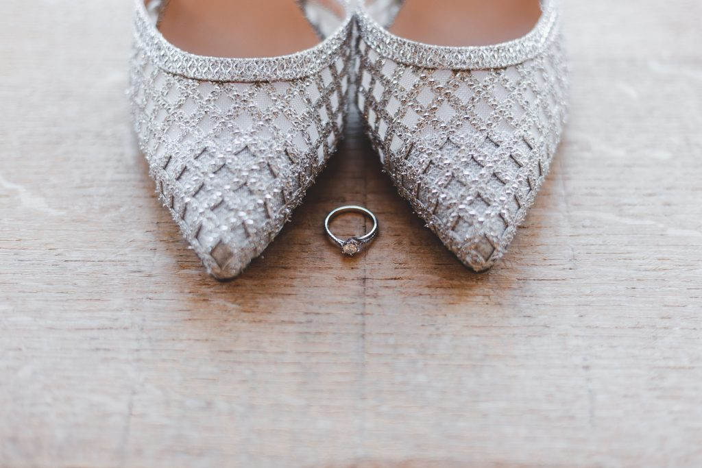 England wedding shoes and ring closeup
