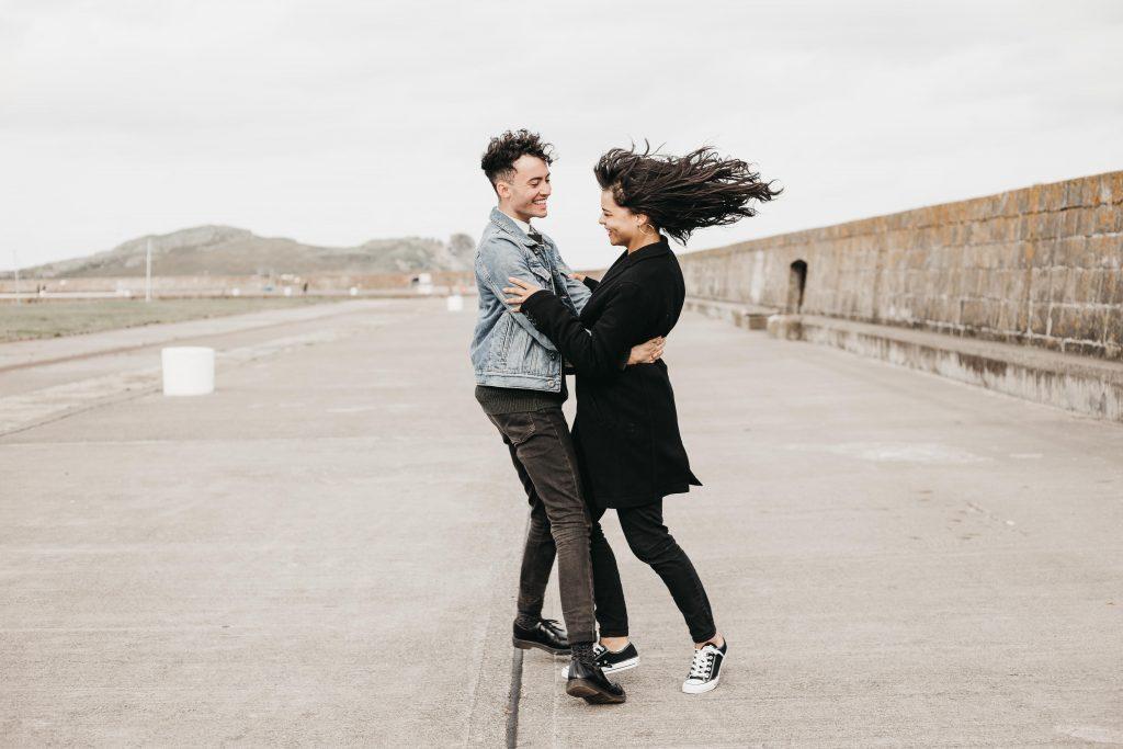 Jodi + Jade Howth engagement shoot spinning aroun
