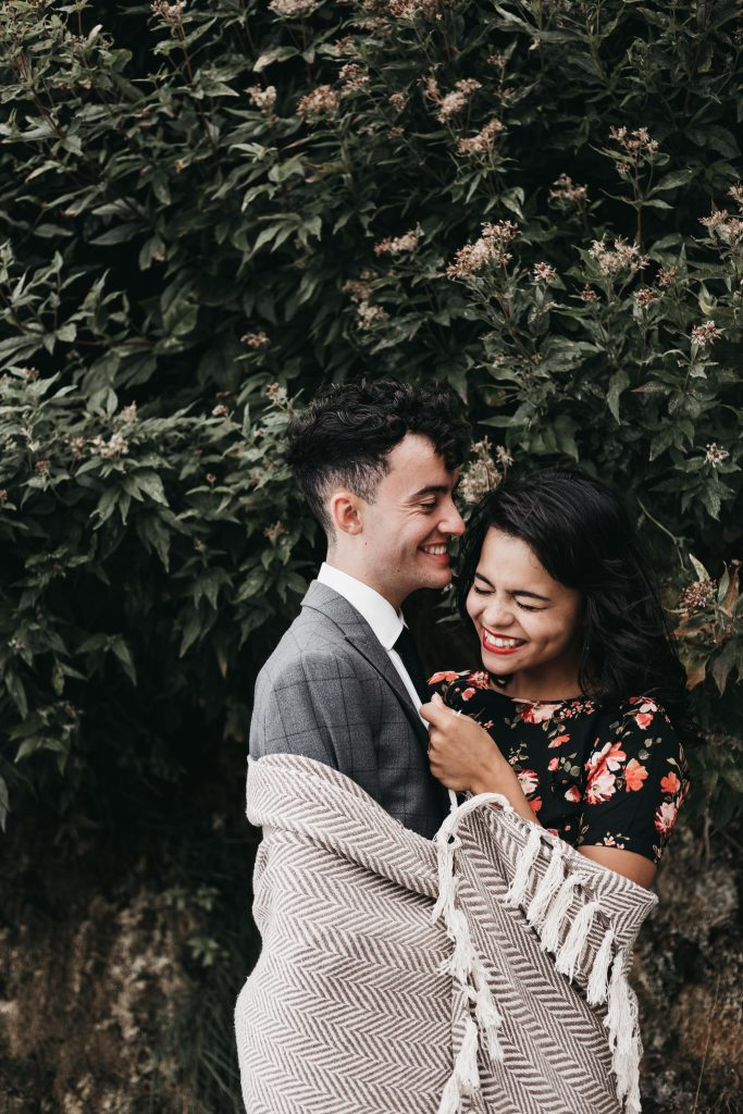 Jodi + Jade Howth engagement shoot wrapped up in a blanket