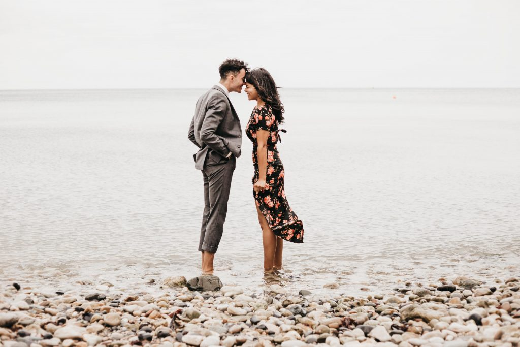 Jodi + Jade Howth engagement shoot standing in the ocean very cold