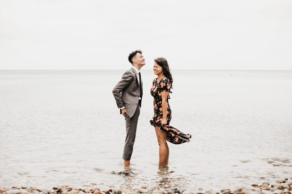 Jodi + Jade Howth engagement shoot standing in ice cold water