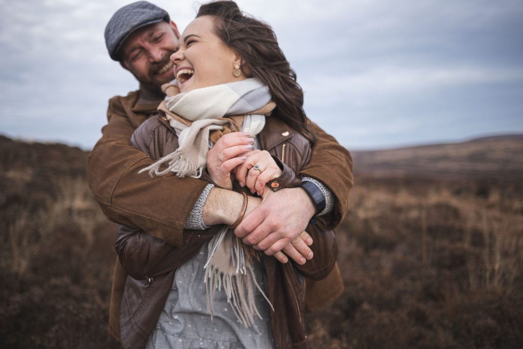 Marli + Andre wicklow mountains engagement shoot couple laughing