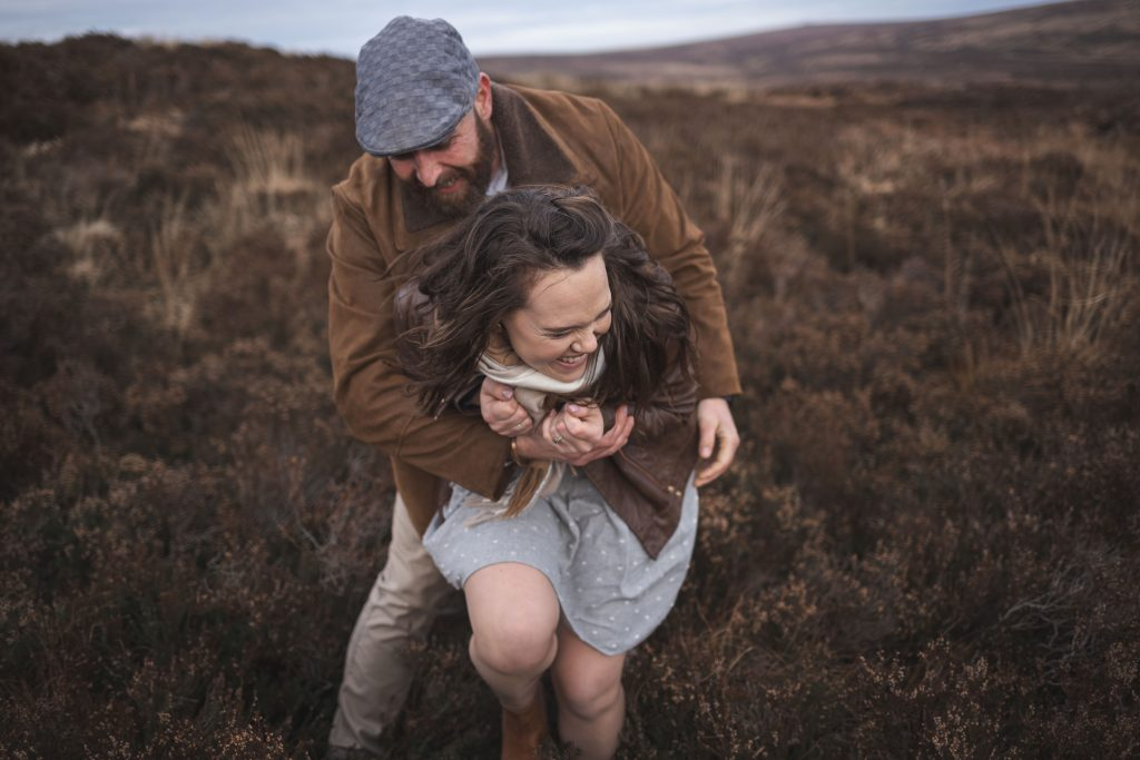 Marli + Andre wicklow mountains engagement shoot couple tickling each other