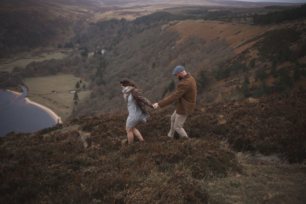 Marli + Andre wicklow mountains engagement shoot holding hands walking down the mountain