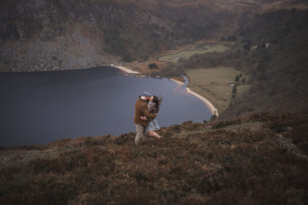 Marli + Andre wicklow mountains engagement shoot dramatic kiss in the wind