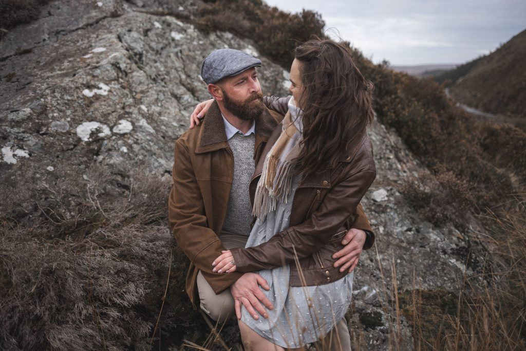 Marli + Andre wicklow mountains engagement shoot couple sitting on a rock