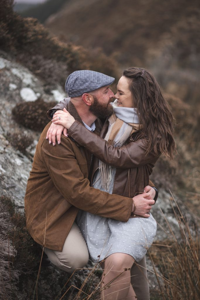 Marli + Andre wicklow mountains engagement shoot kissing on a rock
