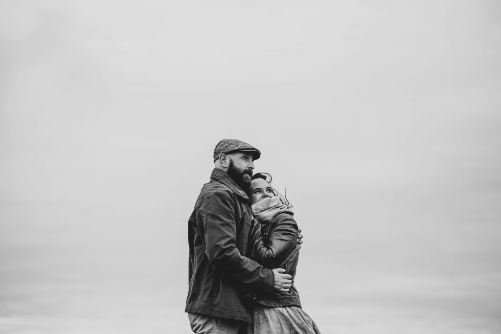 Marli + Andre wicklow mountains engagement shoot couple holding each other black and white