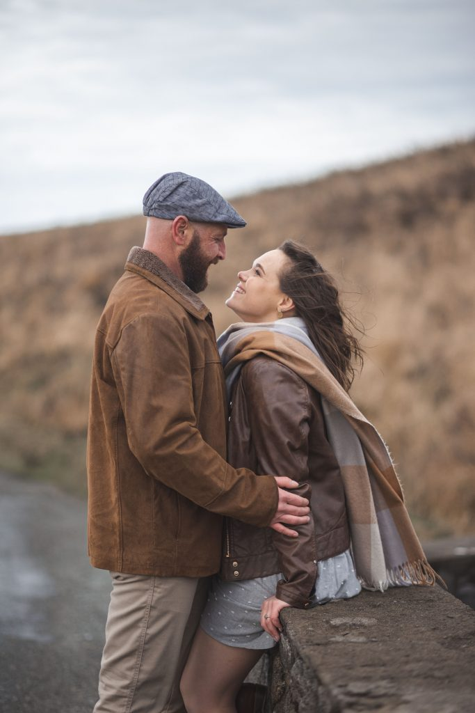 Marli + Andre wicklow mountains engagement shoot couple kissing on the ps i love you bridge