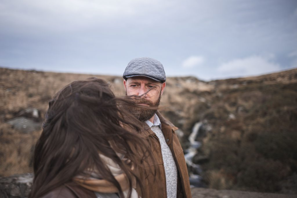 Marli + Andre wicklow mountains engagement shoot couple him looking at her