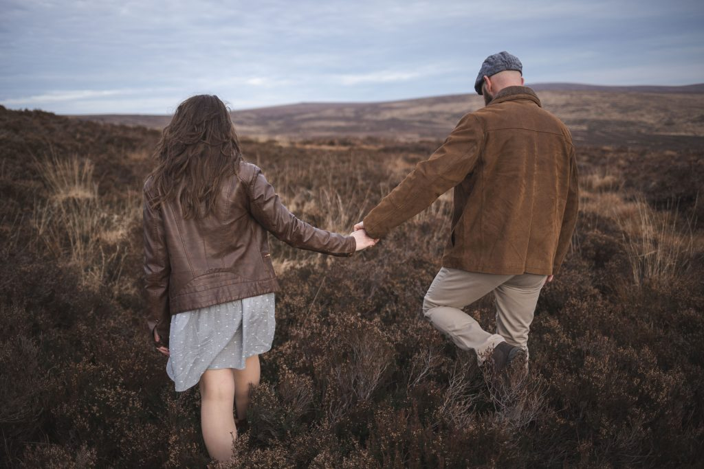 Marli + Andre wicklow mountains engagement shoot couple walking off into the mountains