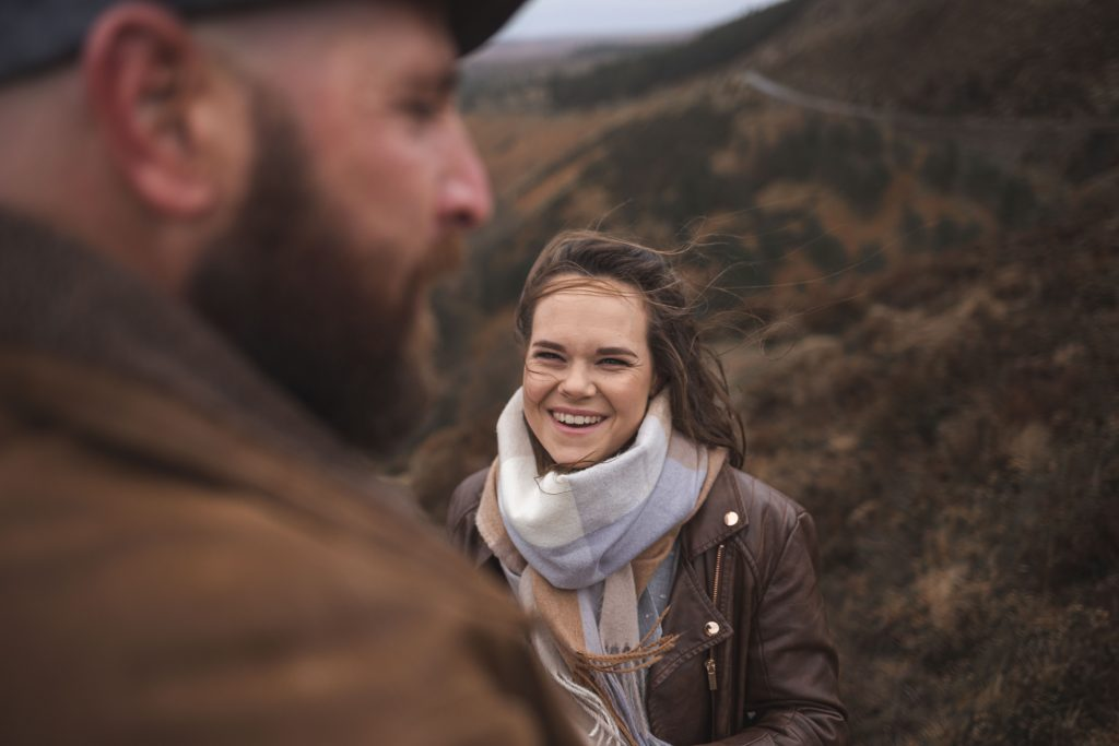 Marli + Andre wicklow mountains engagement shoot smiling at each other