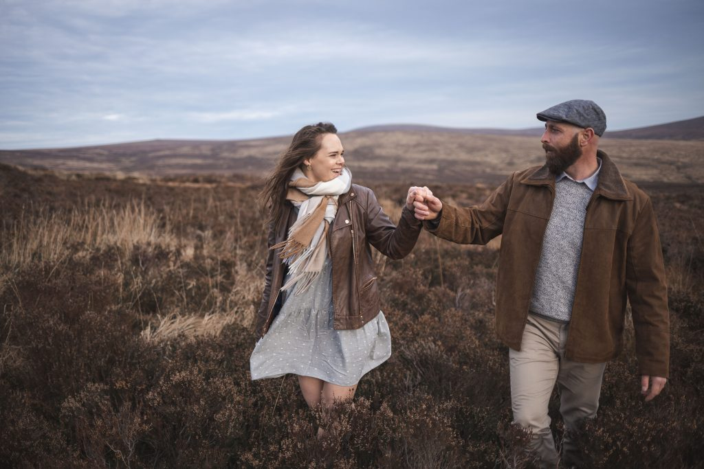 Marli + Andre wicklow mountains engagement shoot couple walking through the bog