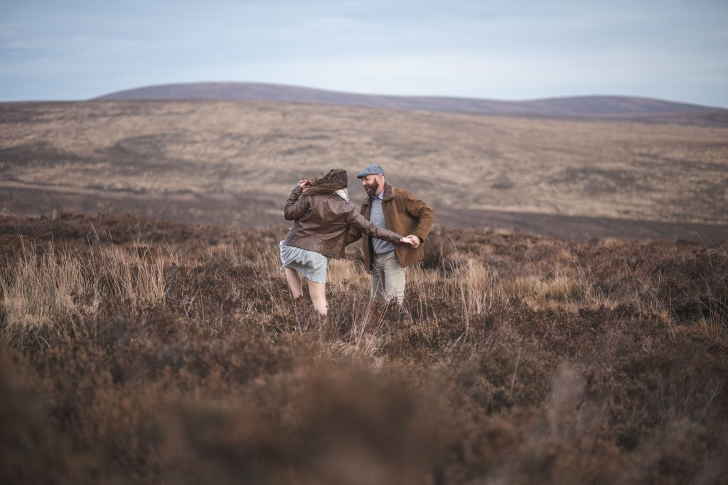 Marli + Andre wicklow mountains engagement shoot couple dancing in the fields