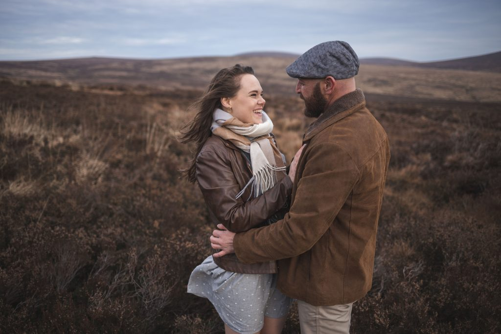 Marli + Andre wicklow mountains engagement shoot couple holding and smiling