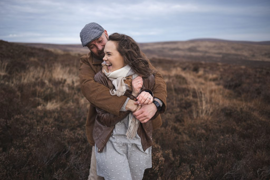 Marli + Andre wicklow mountains engagement shoot couple holding each other and laughing