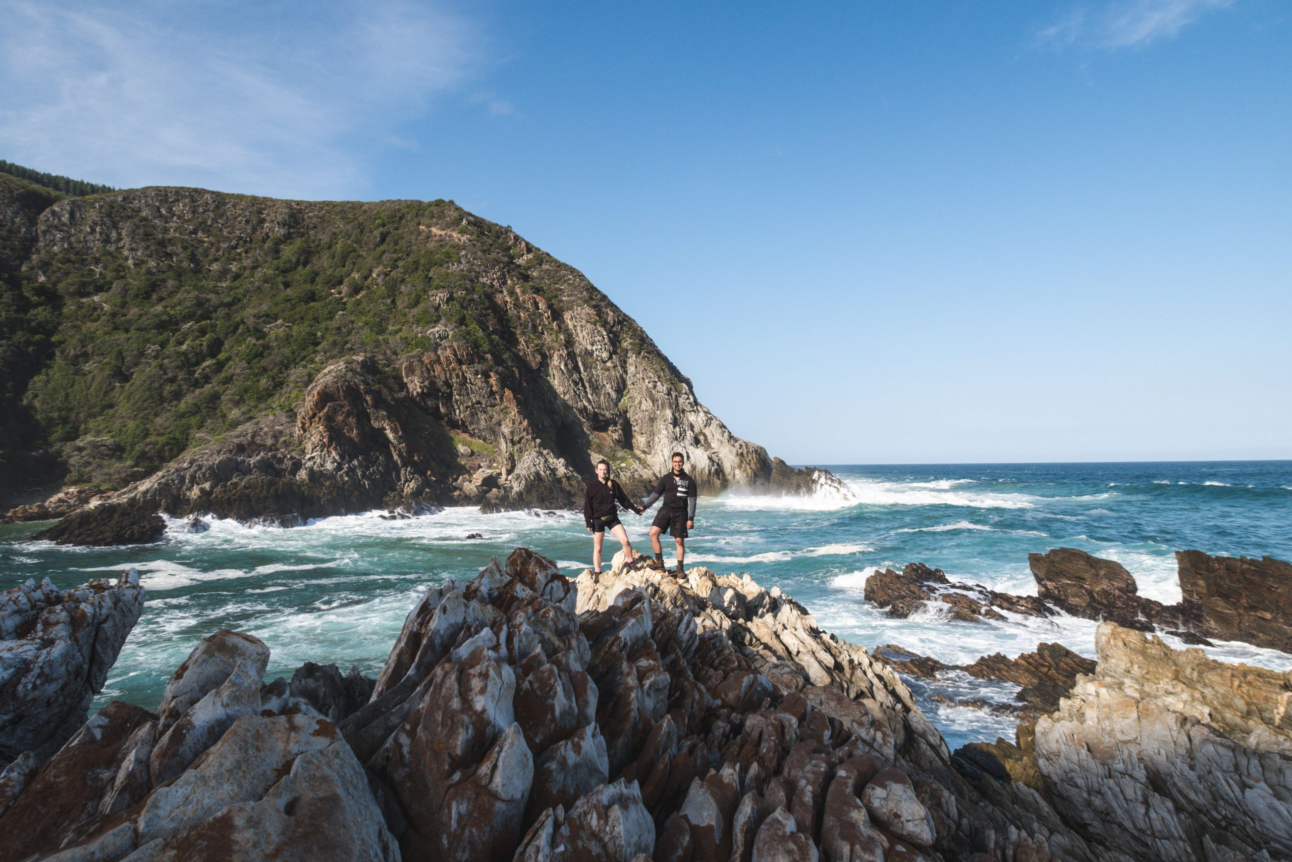 photographers capturing a special moment by the ocean on the otter trail hike