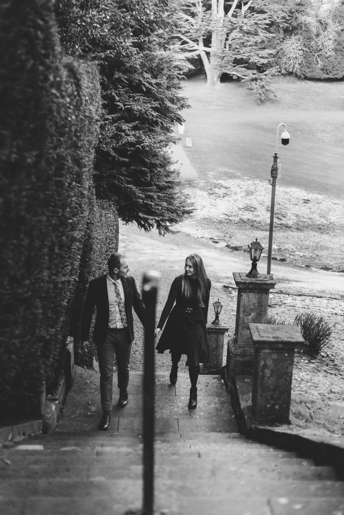 Luke and Kate walking up the stairs at the Wroxton Abbey in Banbury