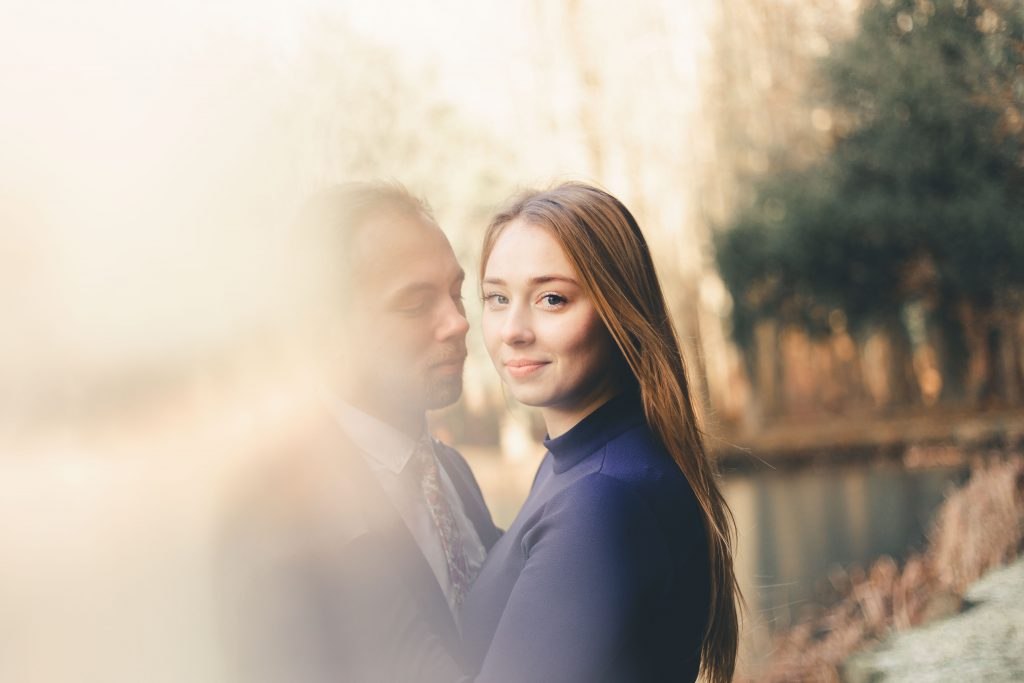 Luke and Kate captured through a piece of ice from the lake at the Wroxton Abbey in Banbury