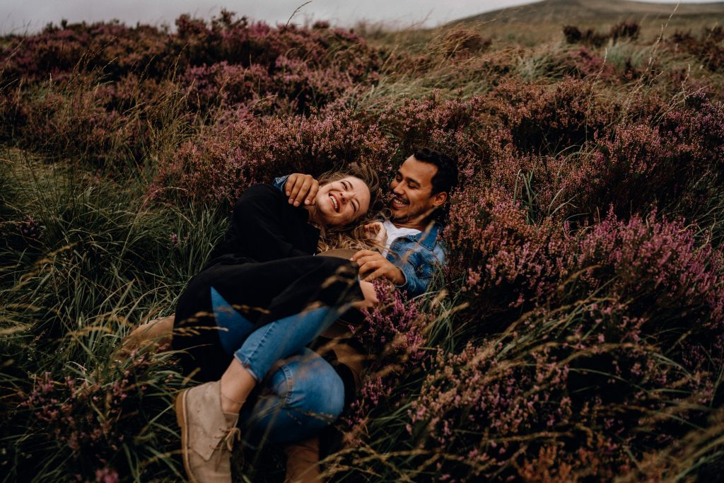 photography couple in dublin cuddling in wicklow heather together