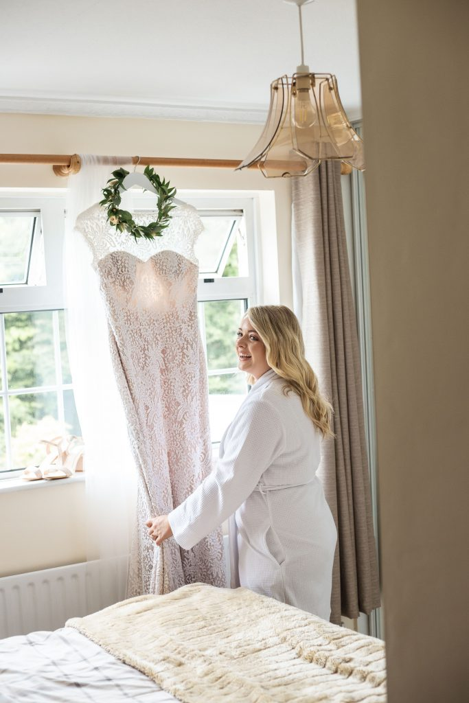 Jack and Katie Antrim elopement bride looking at dress