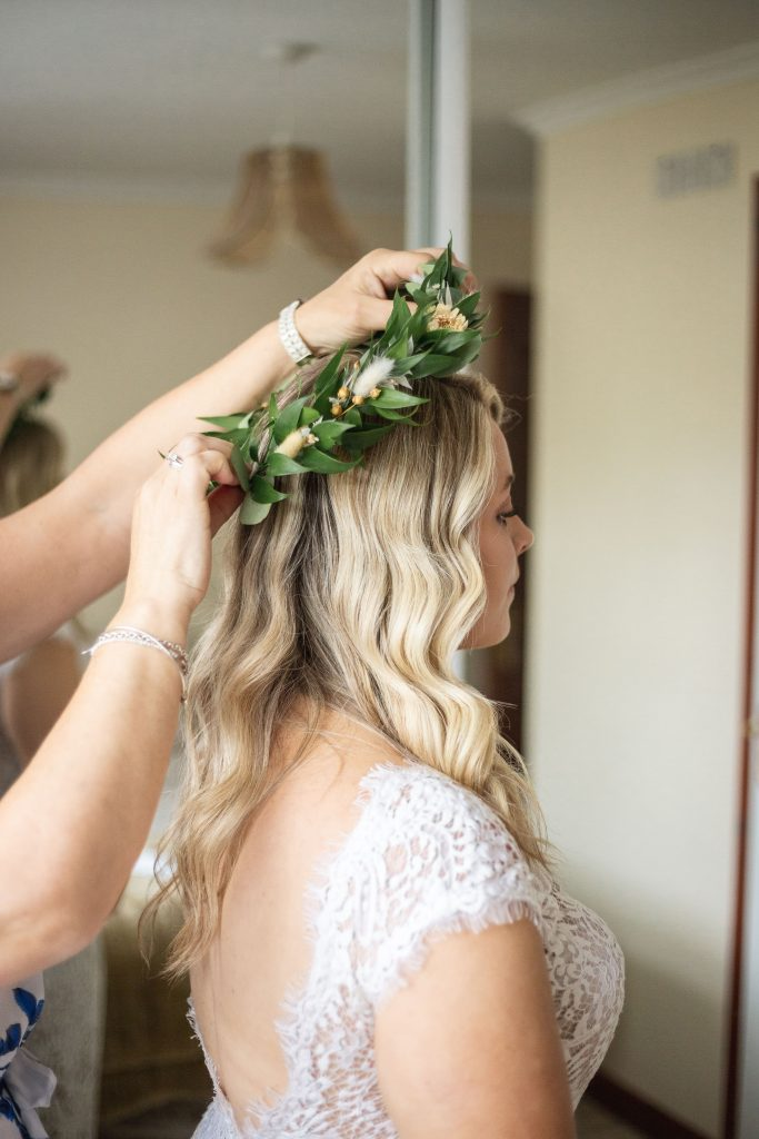 Jack and Katie Antrim elopement putting on a flower crown