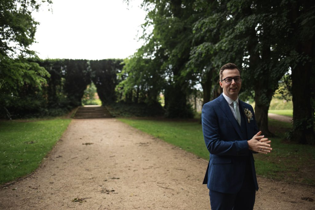 Jack and Katie Antrim Castle gardens elopement groom waiting for the first look