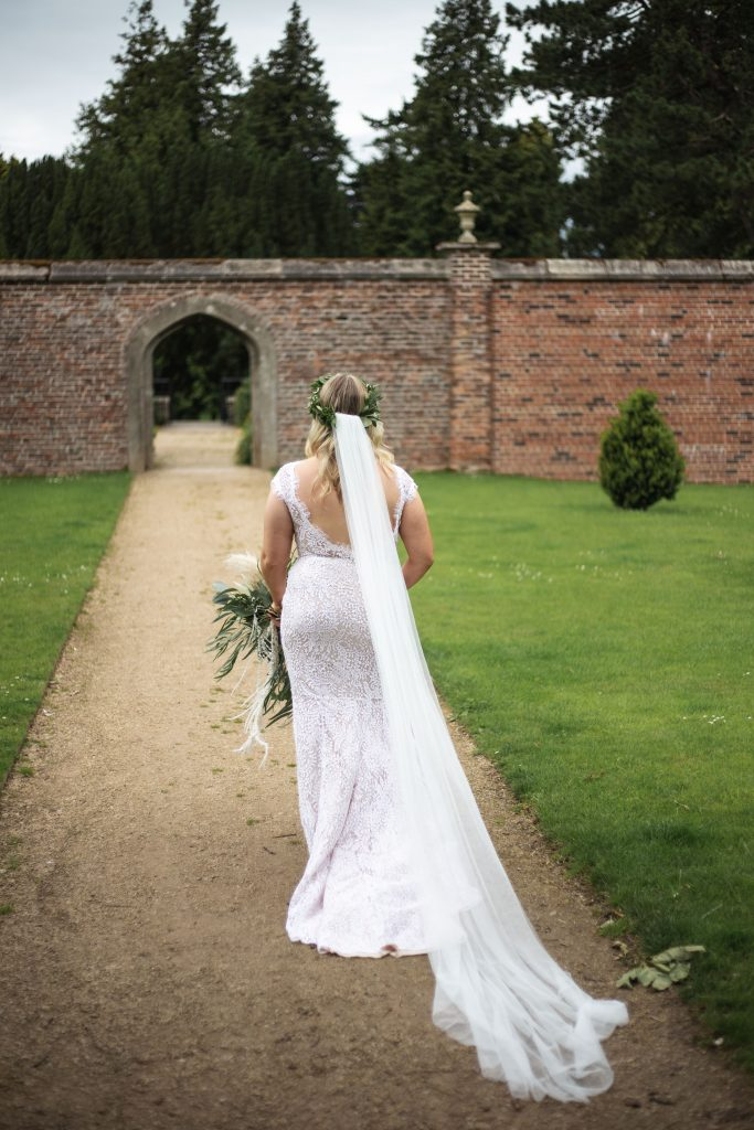 Jack and Katie Antrim Castle gardens elopement bride coming to meet groom for the first look