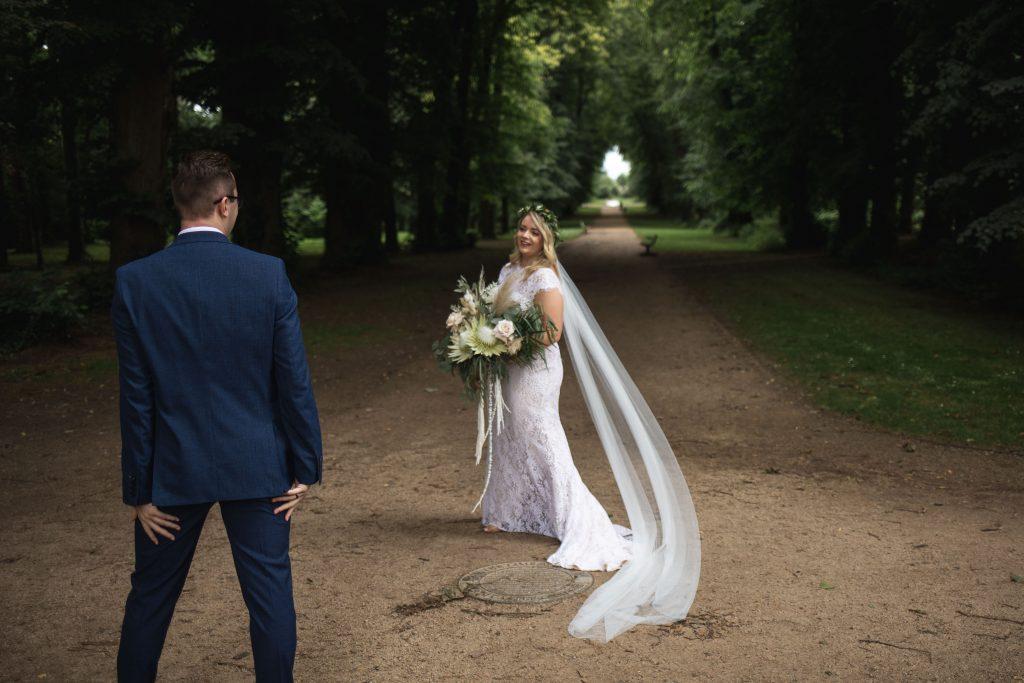 Jack and Katie Antrim Castle gardens elopement groom having his first look