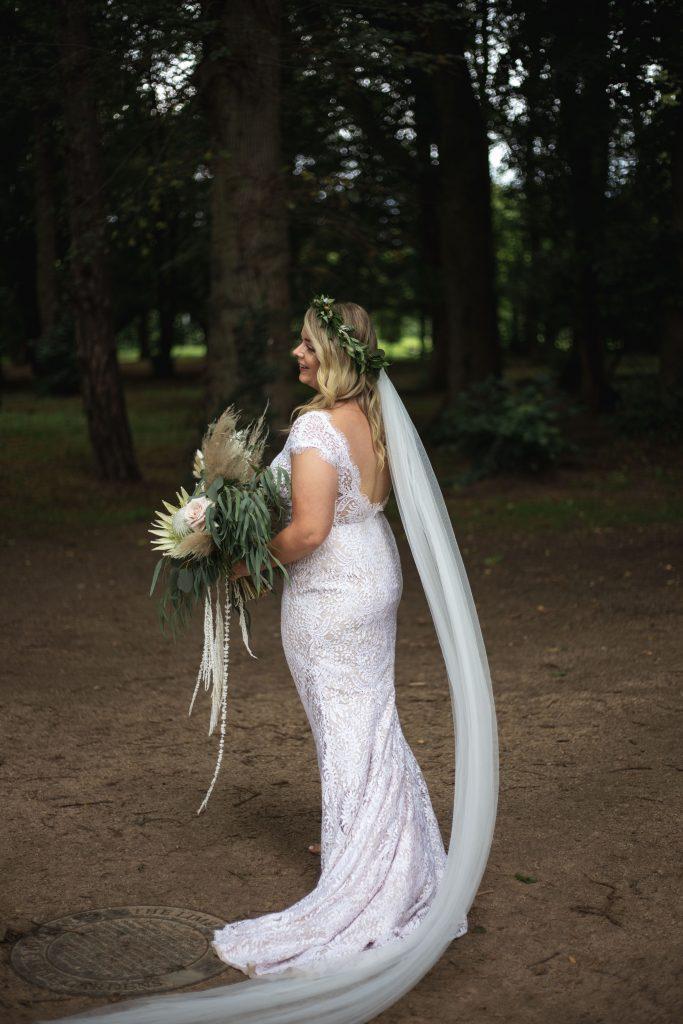 Jack and Katie Antrim Castle gardens elopement bride showing off her dress