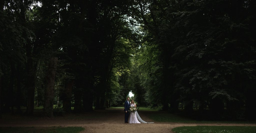 Jack and Katie Antrim Castle gardens elopement posing under the trees