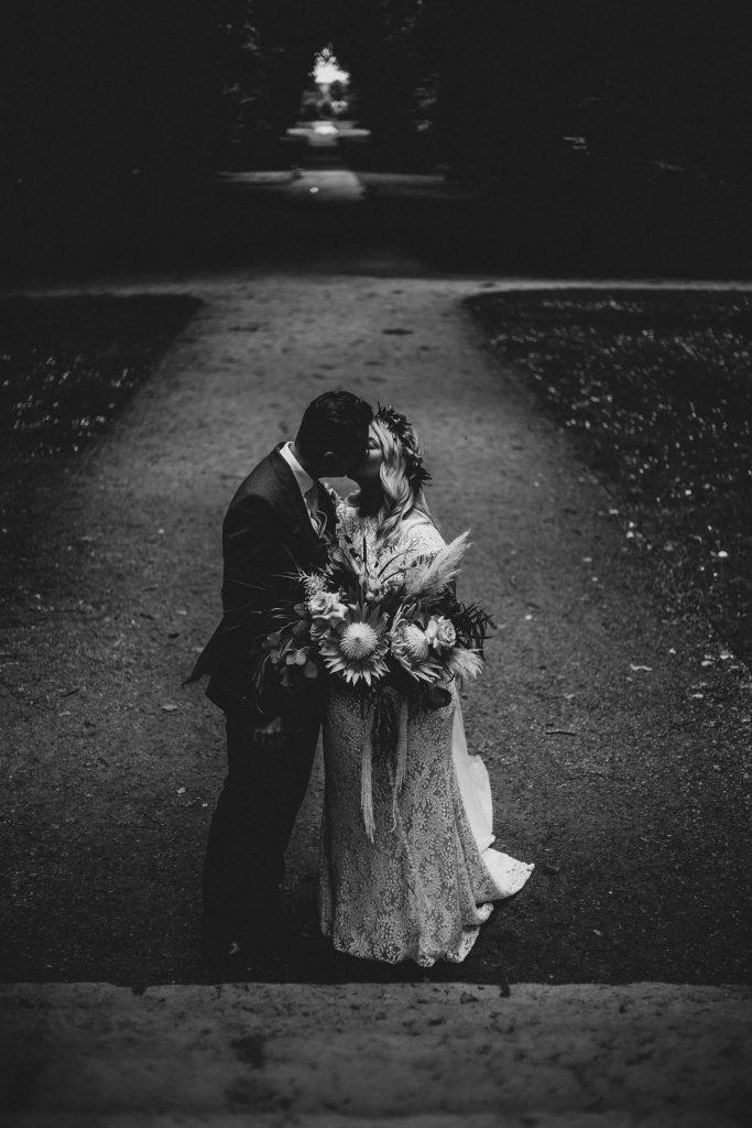 Jack and Katie Antrim Castle gardens elopement kissing