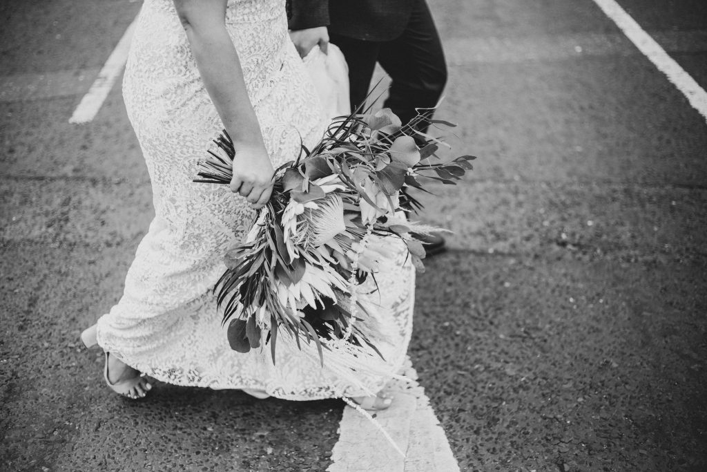 Jack and Katie Antrim Elopement wedding photography walking across the road
