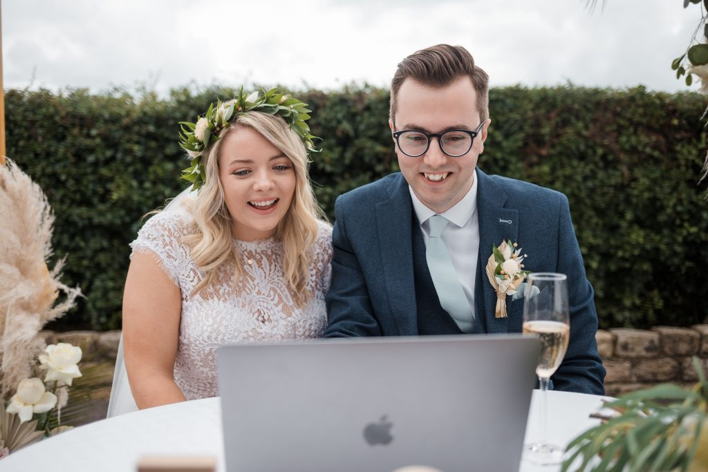 Jack and Katie Antrim Elopement covid zoom wedding photography talking to wedding guests on zoom