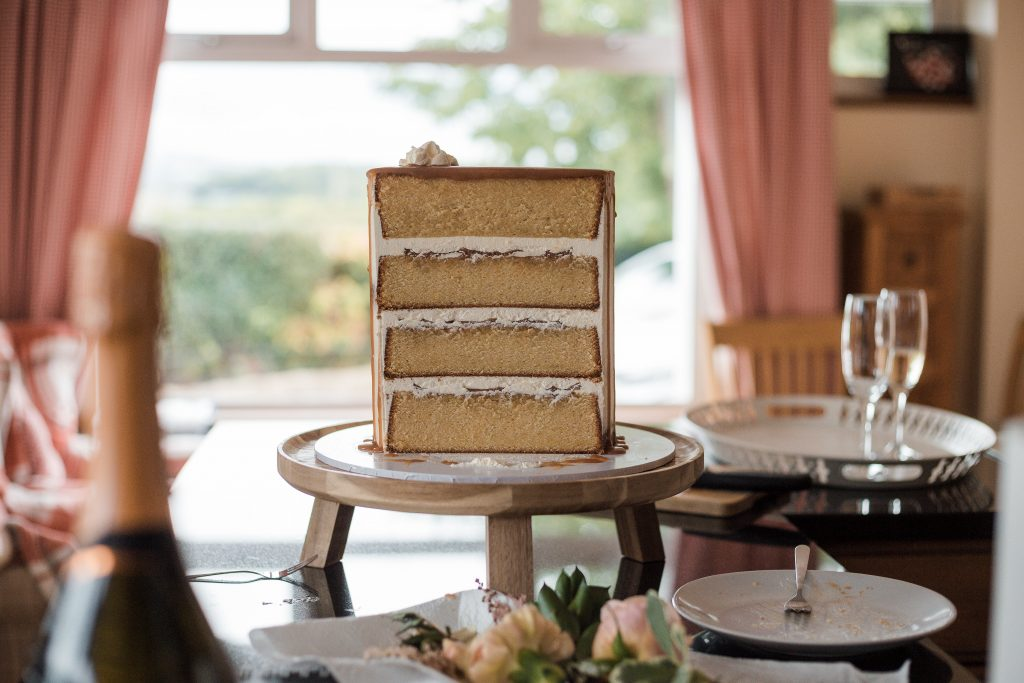 Jack and Katie Antrim Elopement covid zoom wedding photography cut layered wedding cake