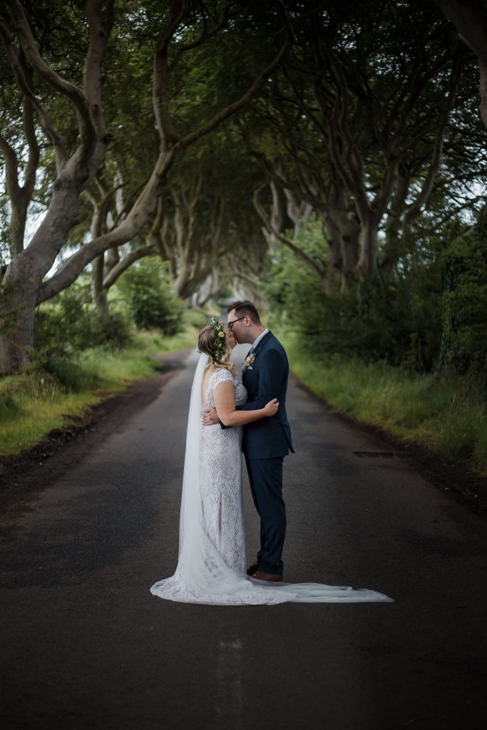 Jack and Katie Dark hedges Elopement wedding photography kissing in the middle of the road