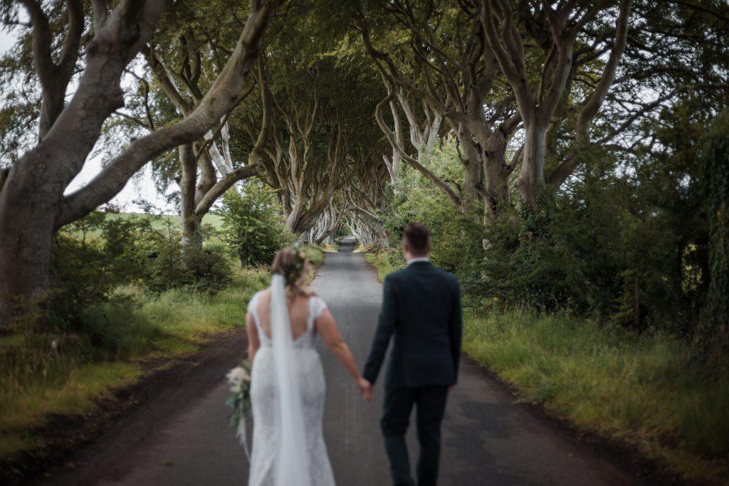 Jack and Katie Dark hedges Elopement wedding photography walking down the dark hedges