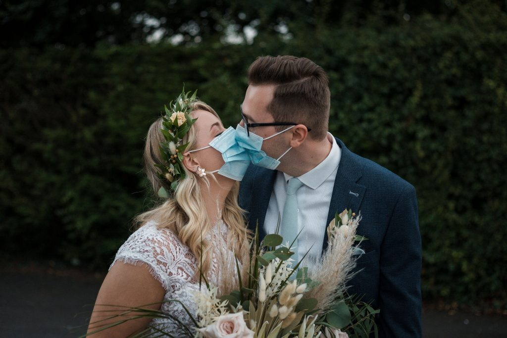 Jack and Katie Antrim Covid Elopement wedding photography couple kissing with face masks