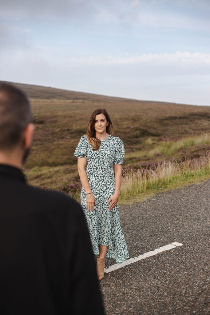 Anna and Colm engagement photography in wicklow mountains looking at fiance