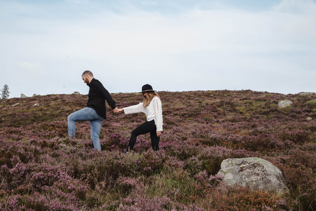 Anna and Colm couples photography in wicklow mountains walking in heather
