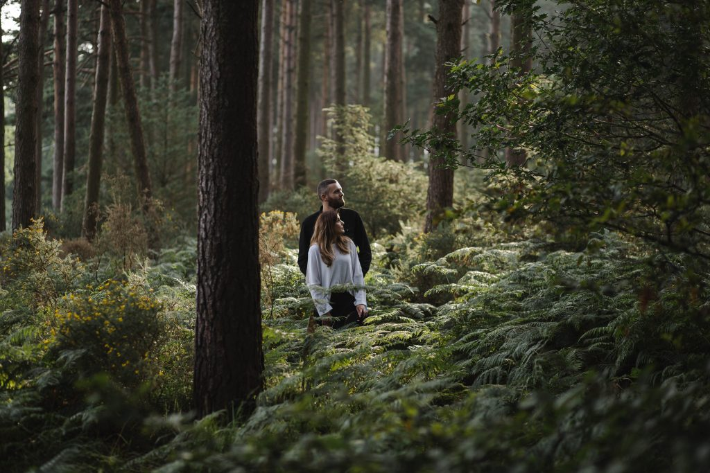 Anna and Colm couples photography in wicklow mountains posing in the forest