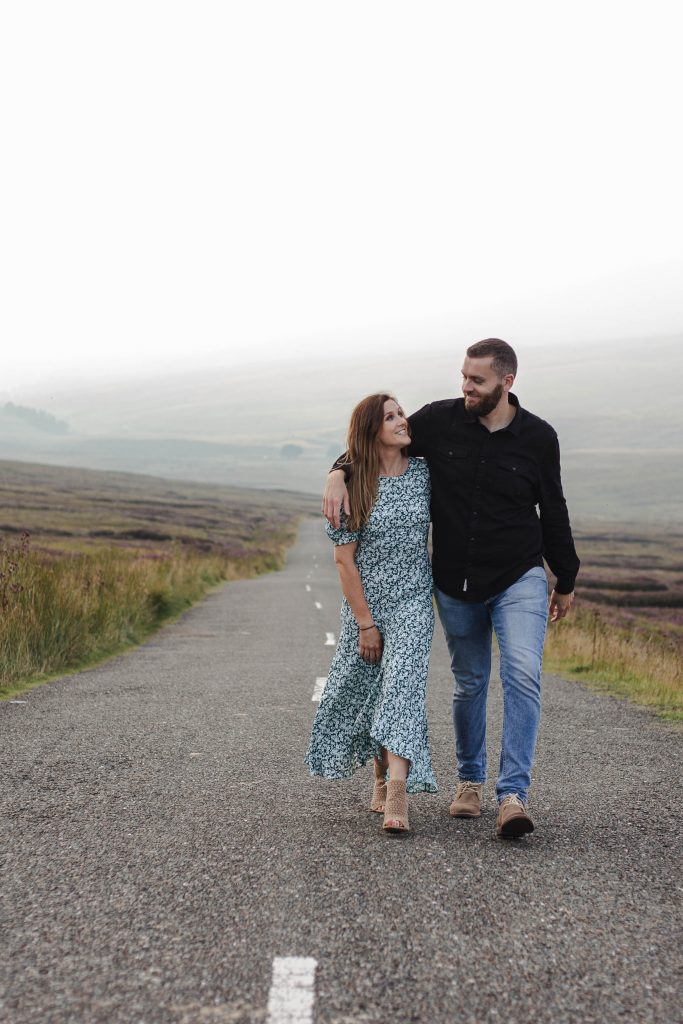 Anna and Colm couples photography in wicklow mountains holding each other