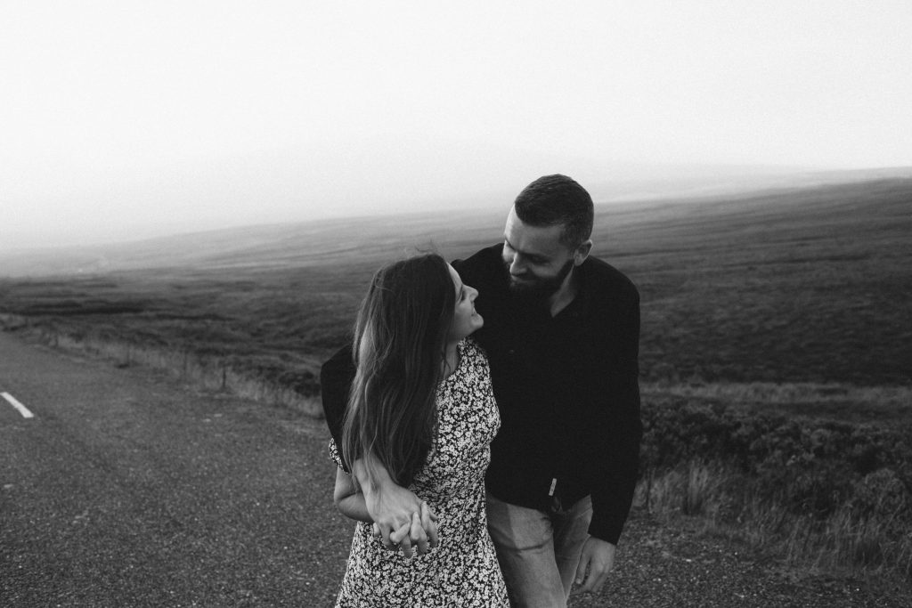 Anna and Colm couples photography in wicklow mountains with the couple looking at each other lovingly