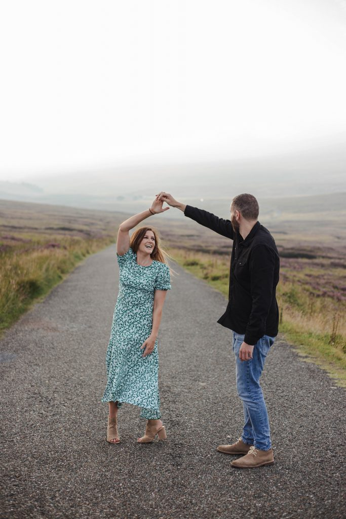 Anna and Colm engagement photography in wicklow mountains dancing in the road