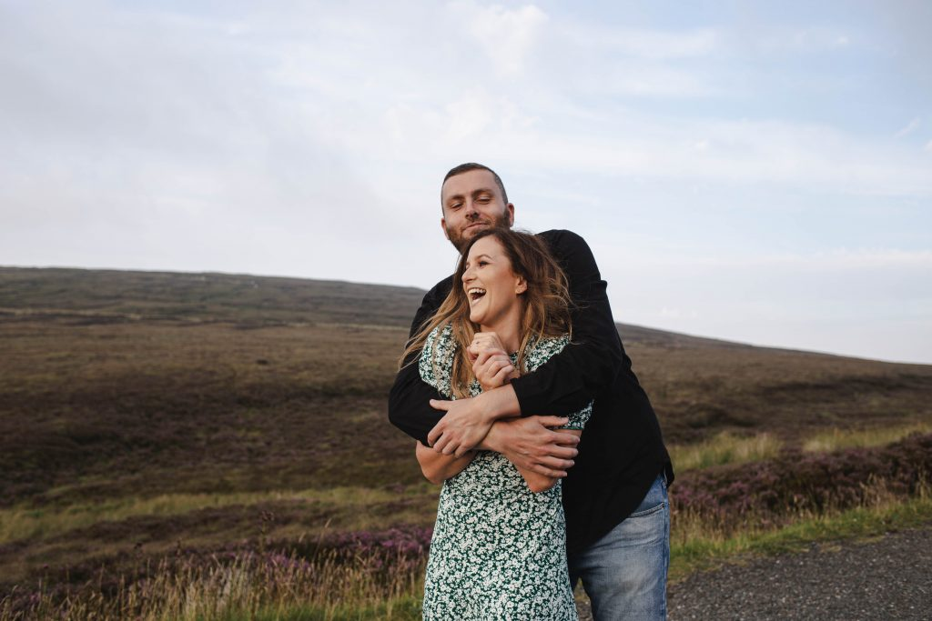 Anna and Colm engagement photography in wicklow mountains beautiful laughing couple