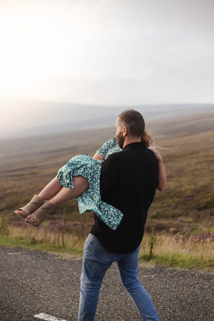 Anna and Colm engagement photography in wicklow mountains fiance being carried