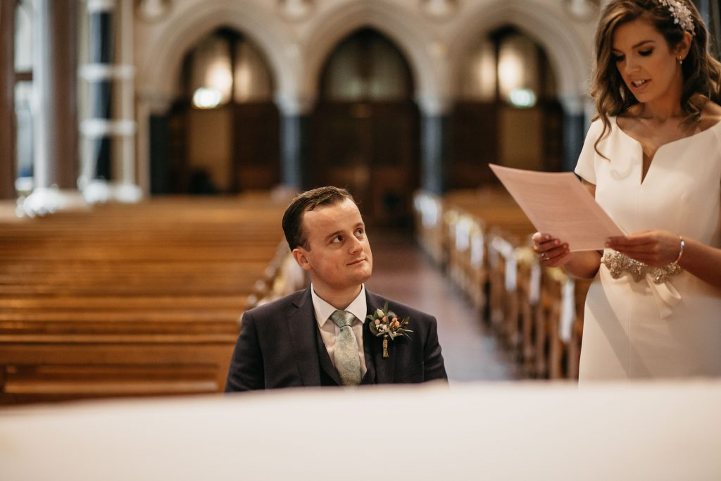 Gemma and Paddy New Ross Intimate wedding St. Mary and Michael Catholic Church groom looking at bride