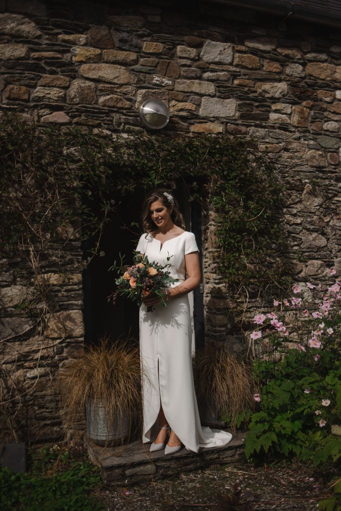 Gemma and Paddy New Ross Intimate wedding bride outside of house