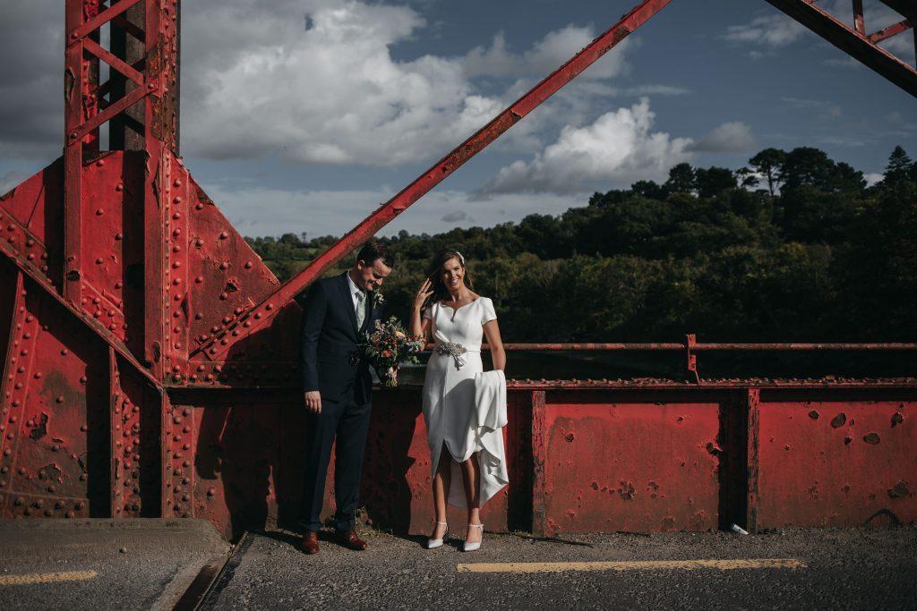 Gemma and Paddy New Ross wedding couple standing on river barrow bridge
